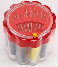 Travel set of sewing supplies in a plastic box