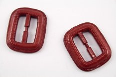 Plastic clothing buckle - red - pulling hole width 2,5 cm - dimensions 3,8 cm x 3,2 cm