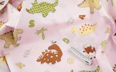 Cotton canvas - pale pink with dinosaurs