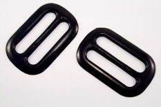 Plastic clothing buckle - black - pulling hole width 4,5 cm - dimensions 6,5 cm x 4 cm