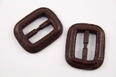 Plastic clothing buckle - brown - pulling hole width 2,5 cm - dimensions 3,8 cm x 3,2 cm