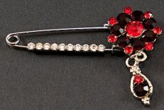 Clothing brooch with red and black crystals - black, red - size 5.5 cm x 4 cm