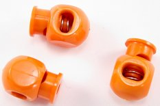 Plastic round cord lock - orange - pulling hole diameter 0.9 cm