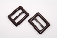 Plastic clothing buckle - brown  - pulling hole width 3,1 cm - dimensions 4,3 cm x 3,5 cm